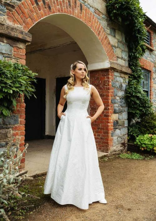 Embroidered silk dupion sleeveless bridal gown