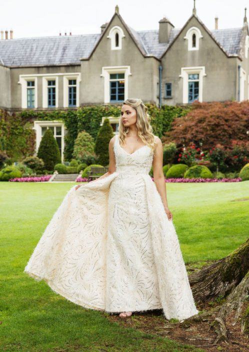 Shell pink and ivory sleeveless bridal gown